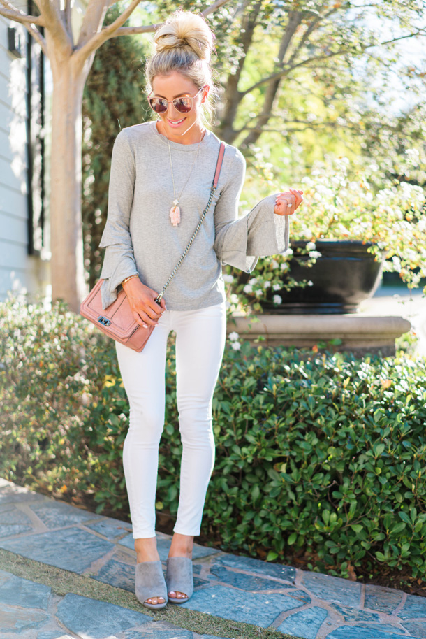 Fashion blogger Katelyn Jones of A Touch Of Pink from Orange County wears a grey and white outfit with pops of pink for Spring