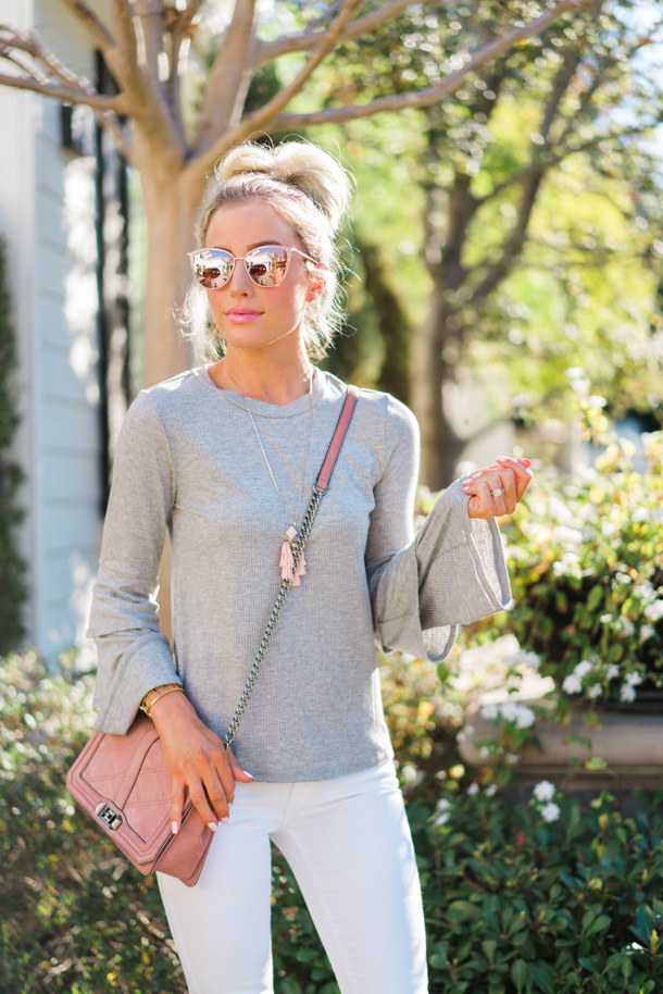 Lifestyle blogger Katelyn Jones of A Touch Of Pink wears a Rebecca Minkoff Blush Pink Quilted Crossbody Bag