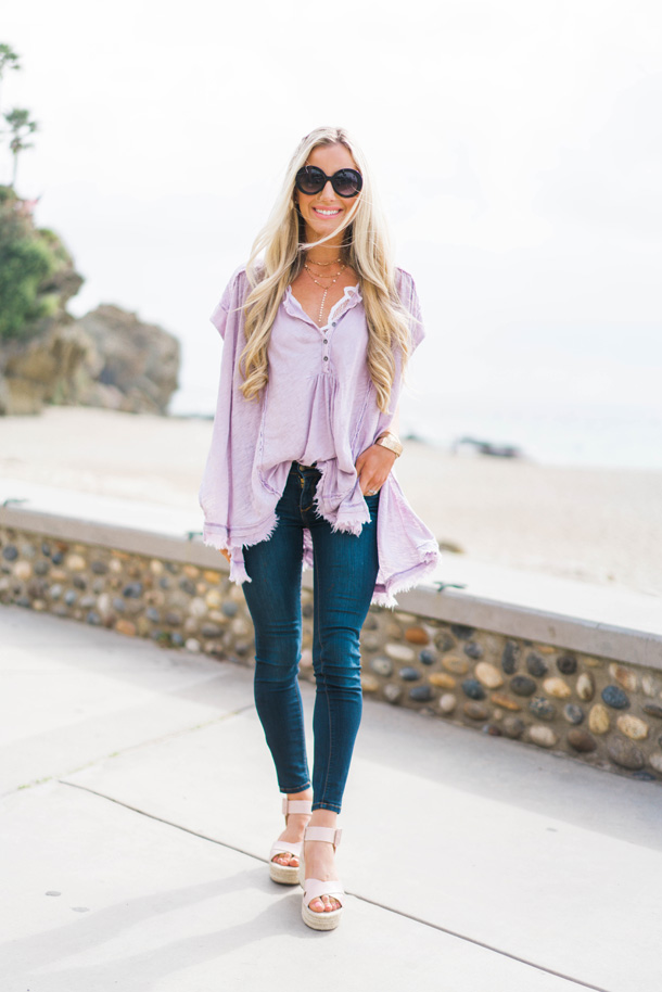 Lifestyle blogger Katelyn Jones of A Touch Of Pink wears a Free People Henley flowy top