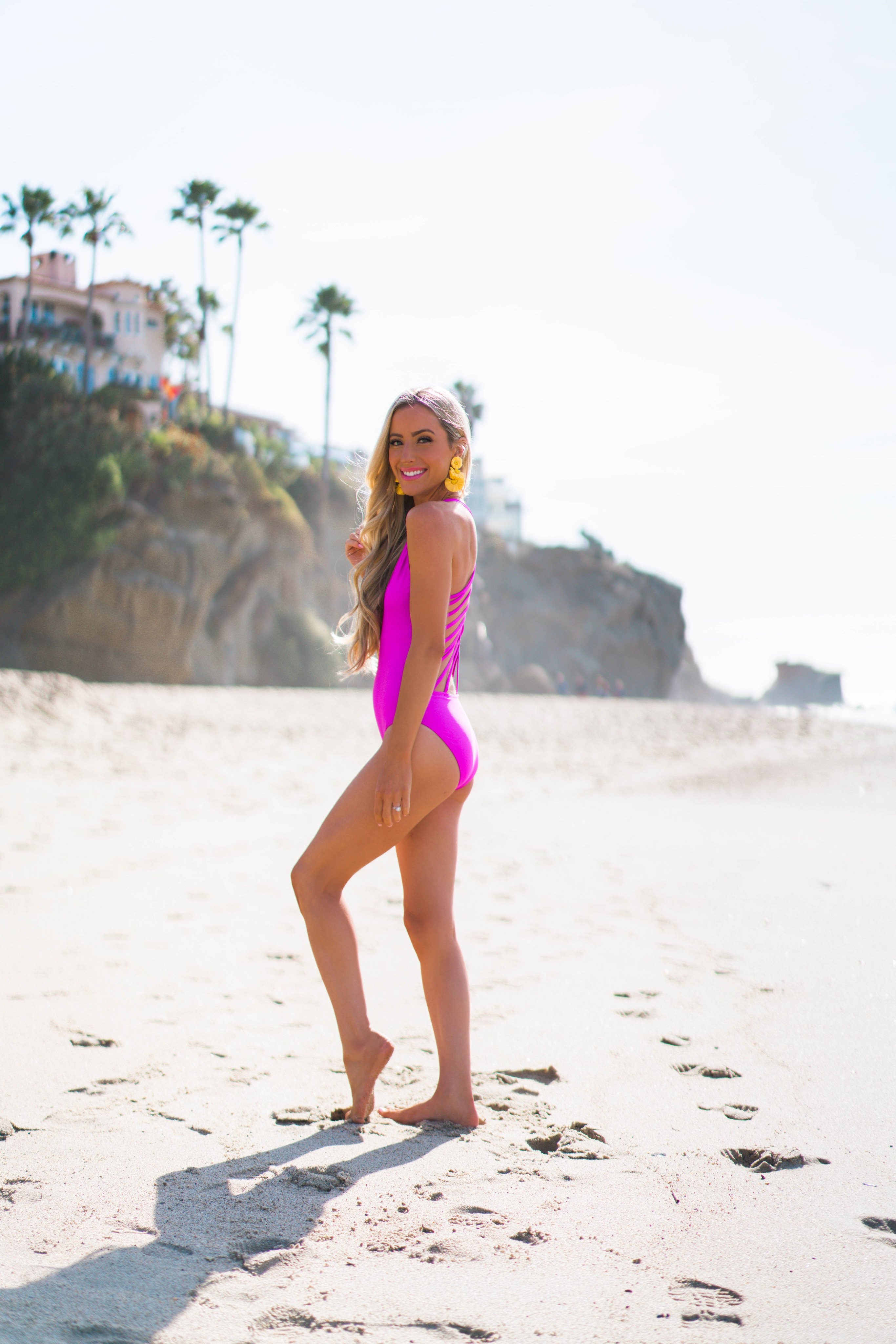 Orange County fashion and Lifestyle blogger Katelyn Jones of A Touch Of Pink wears a Red Dress Boutique One-Piece Swimsuit