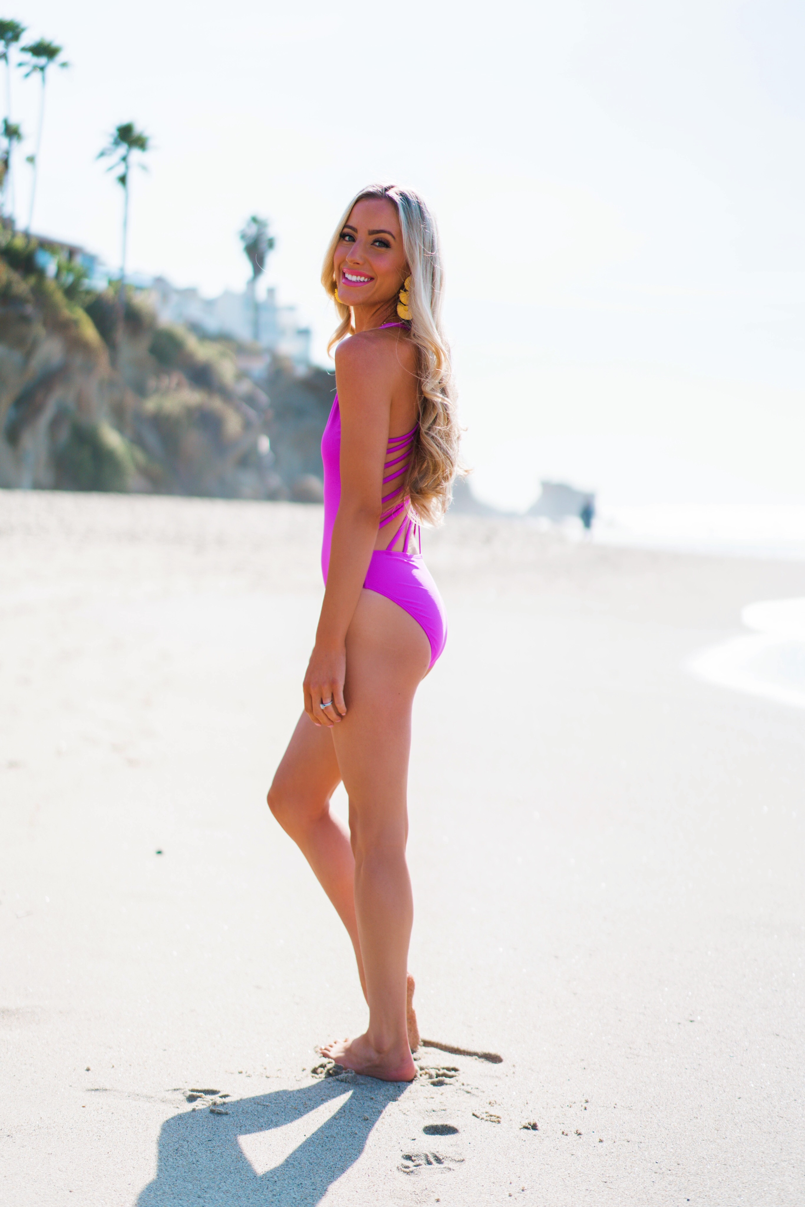 California Lifestyle blogger Katelyn Jones of A Touch Of Pink wears a Red Dress Boutique Swimsuit